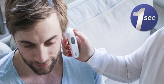 Man with his ear temperature being taken with Braun ThermoScan 3