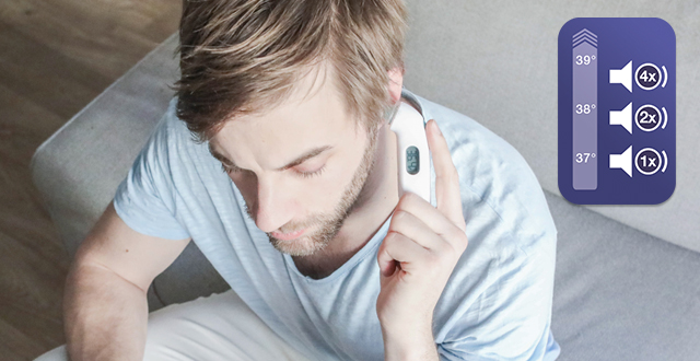 Man taking his ear temperature with Braun ThermoScan 3
